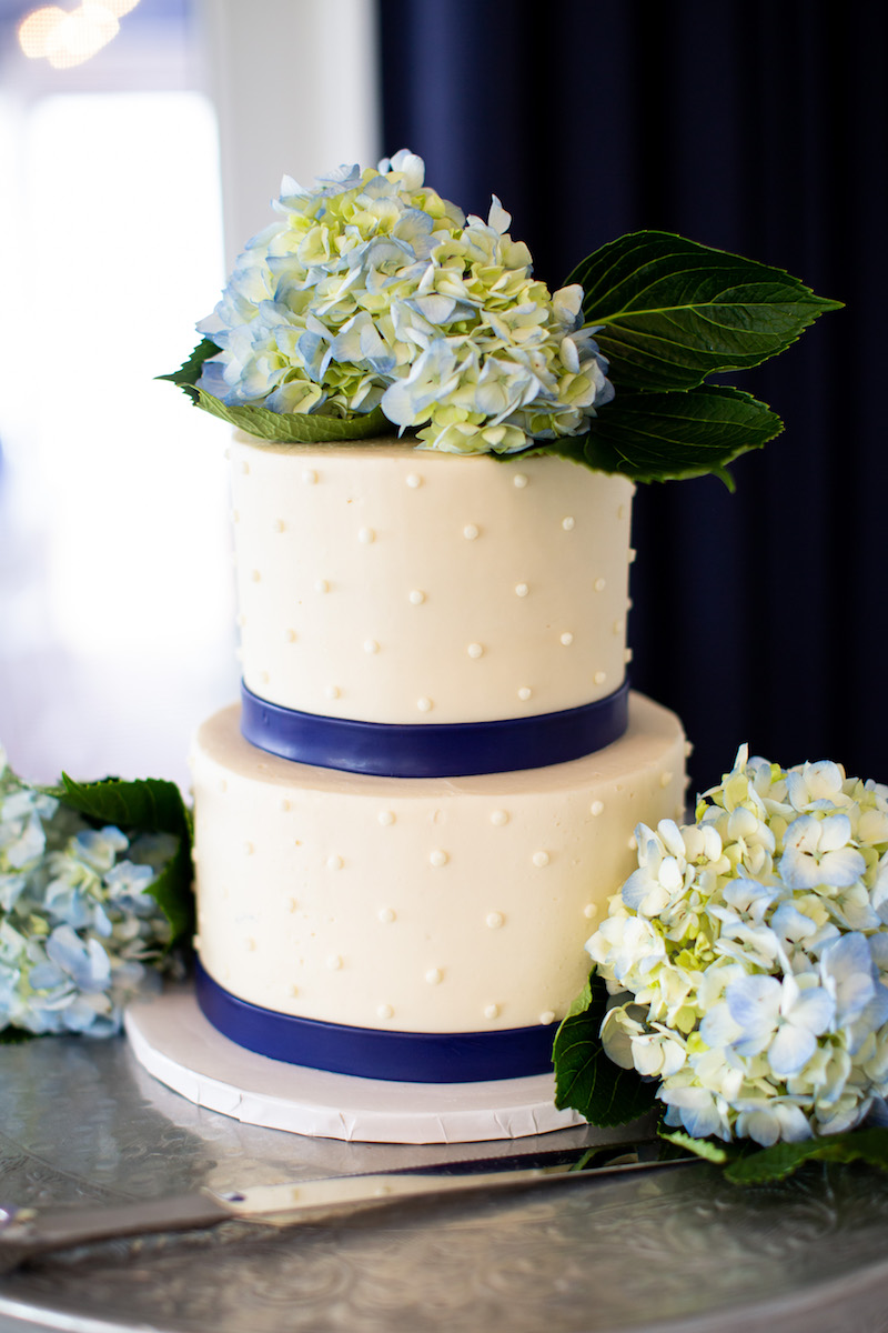 Wedding cake decorated with blue hydrangea